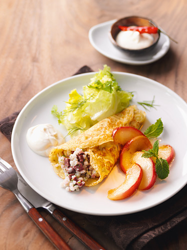 Stuffed marjoram crêpe with black pudding barley and apple wedges