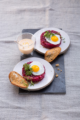 Beetroot tatar with quail eggs, bread crisps and hollandaise sauce