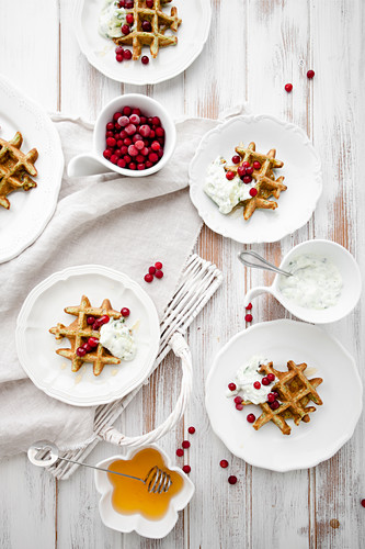 Spinach waffles with greek tzatziki, honey and lingonberries