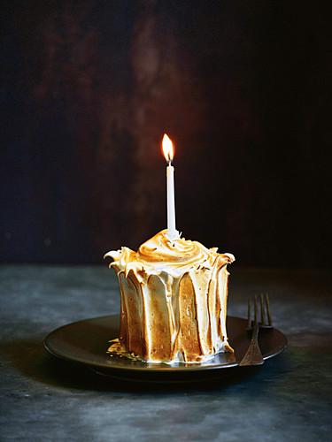 Lemon meringue cake with burning candle