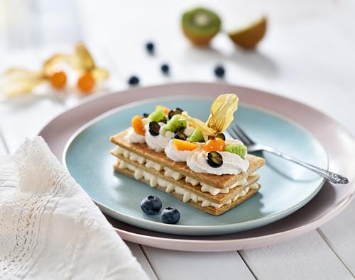 Mille feuille with vanilla cream, kiwis, blueberries and physalis (vegan)
