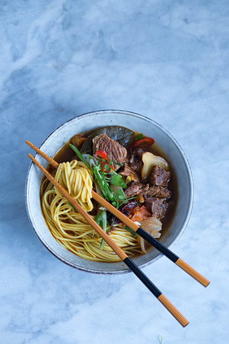 Asian noodle soup with beef and vegetables