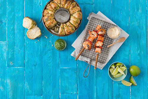 Pull-apart bread and prawn and salmon skewers