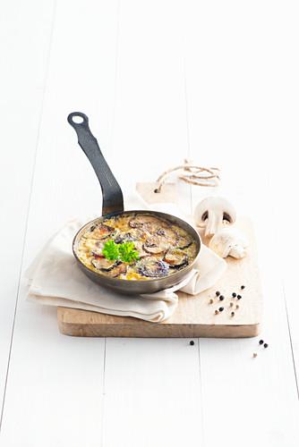 A mushroom omelette in a pan