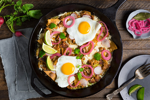 Chilaquiles with salsa verde, chorizo and eggs