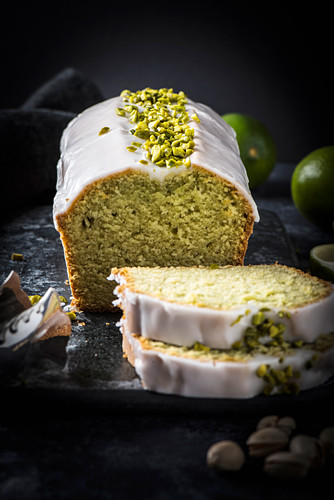 Avocado and lime cake with lime icing and chopped pistachios