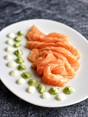 Salmon sashimi with dips on a serving platter (Japan)