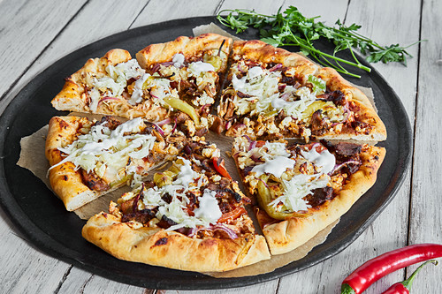 Donner kebab pizza with coleslaw and yoghurt sauce