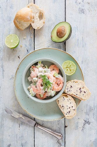 Prawn salad with avocado, cucumber, a light yoghurt cocktail sauce and truffle butter baguette