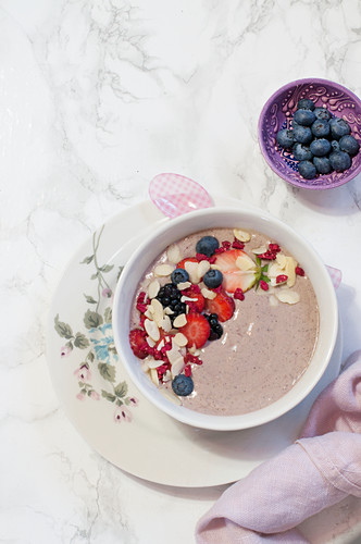 A breakfast bowl with acai berries and almond flakes