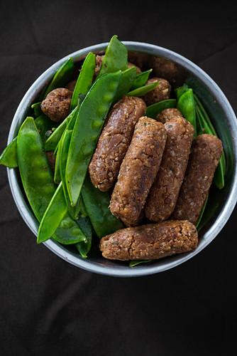 Vegan cevapcici with mange tout