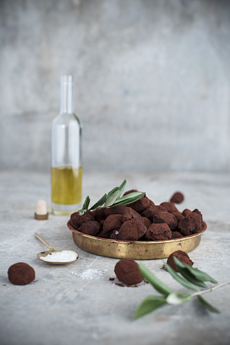 Homemade chocolate truffles with cocoa powder and olive oil