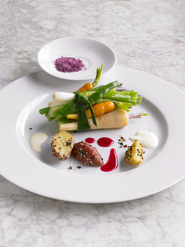 A vegetable bundle with sesame potatoes and beetroot salt