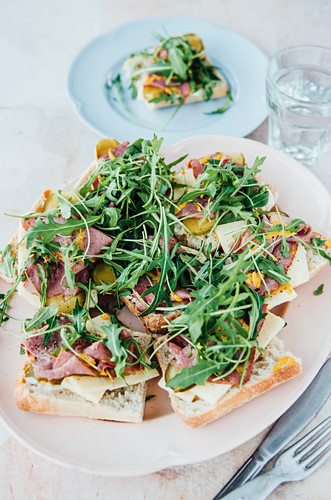 Sandwiches with pastrami, cheese and rocket