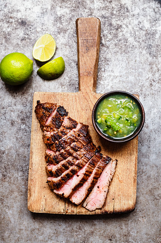 Grilled flank steak with green tomato salsa