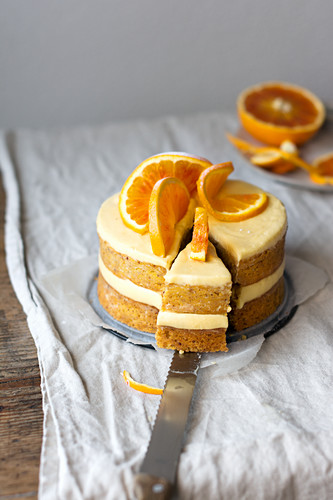 A layered orange cake, sliced