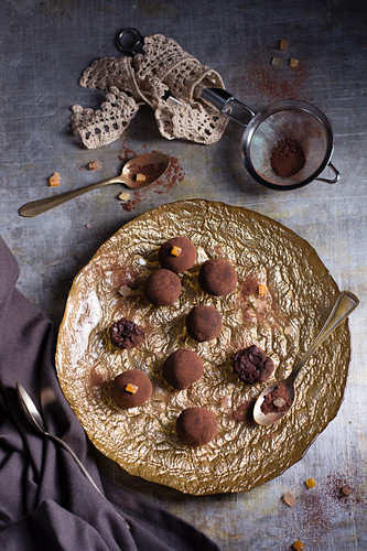 Spiced chocolate truffles on a golden plate