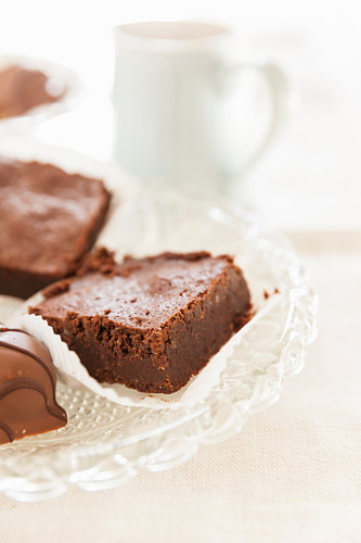 Brownies and chocolate confectionery on a glass dish