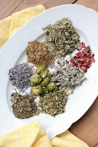 Ingredients for a soothing pillow of hops, dried roses and herbs