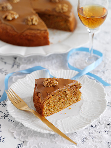 A slice of coffee and walnut cake