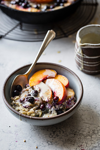 Super seedy vegan baked oatmeal with peaches and huckleberries