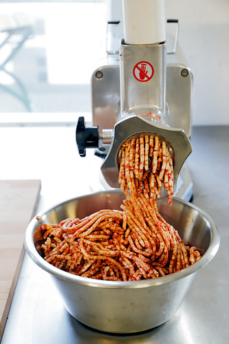 Minced pork in a mincer