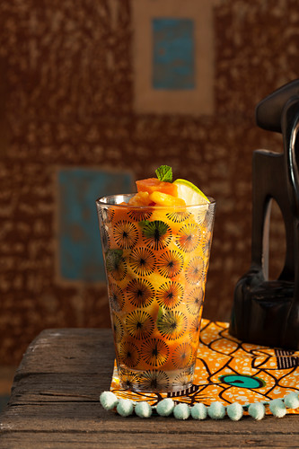 An aperitif with exotic fruits and gin (Africa)