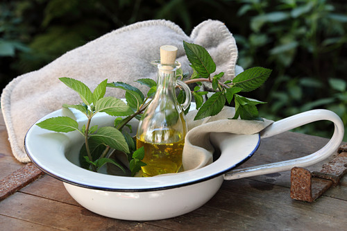 Peanut oil with peppermint and rosemary for a stomach massage to treat digestive problems