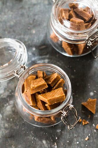 Caramel sweets with fleur de sel in jars