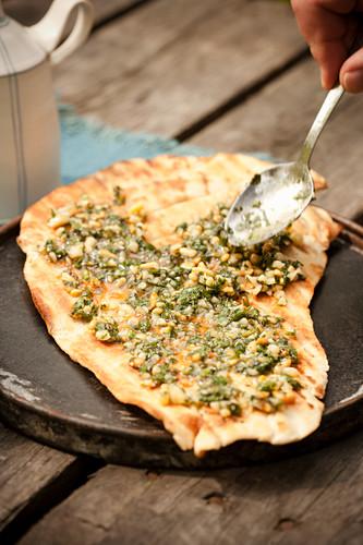 Pizza spread with pesto