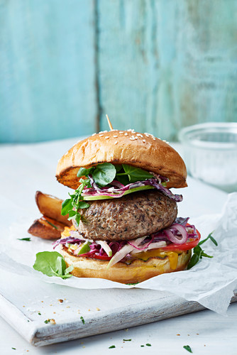 Lamb and mint burger with apple slaw in a brioche bun