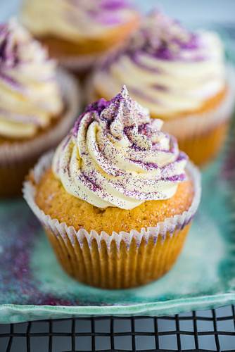 Cupcakes with buttercream and purple glitter