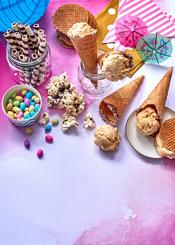 Popcornand caramel ice cream in waffle cones