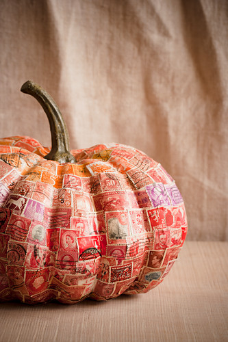 Pumpkin decorated with red stamps