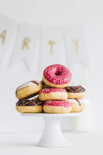 Donuts with different glazes on a cake stand