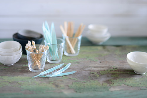 Kitchen utensils for finger food: bowls, toothpicks, and a glass of feathers