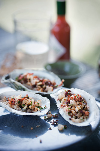 Oysters with pancetta and pine nuts