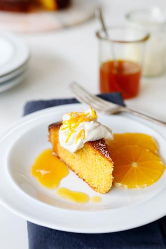 Orange Polenta Cake served with an orange, honey syrup and whipped cream