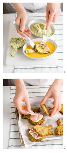 A breaded artichoke sandwich being made