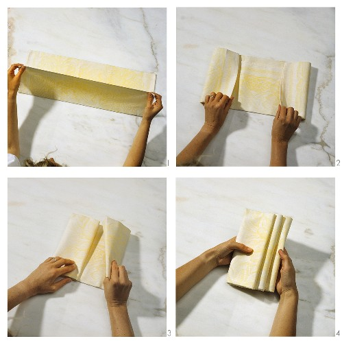 """Step-by-step guide to folding a """"staircase napkin"""""""