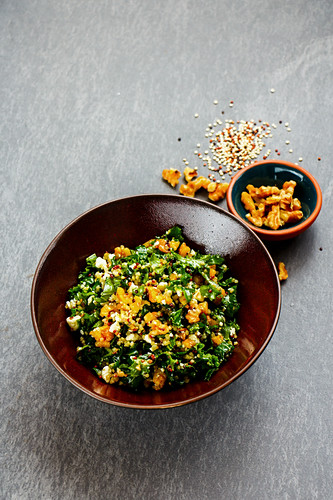 Kale salad with quinoa, feta cheese and walnuts