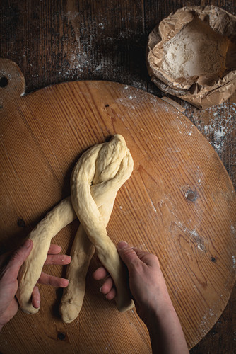 Challah bread (Jewish cuisine) being made: dough being plaited