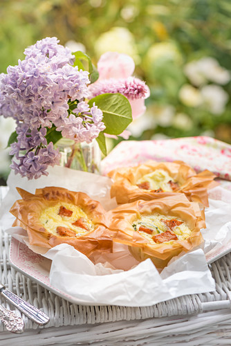 Mini filo pastry quiches with sweet potatoes and cabbage for a summer picnic
