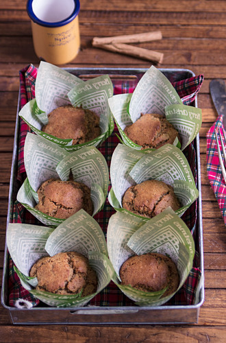 Winter cinnamon and ginger muffins in paper cases