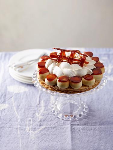 A vegan Saint Honoré cake with a caramel lattice and soya cream