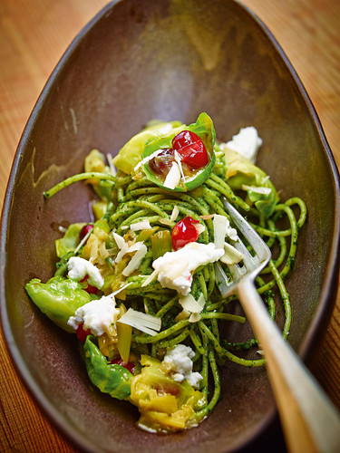 Spaghetti with cranberries and brazil nut and parsley pesto