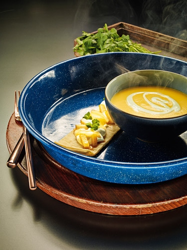 Butternut squash soup with wasabi cream and pears