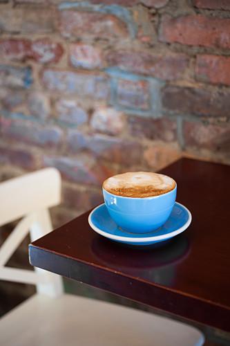 A caffe latte on a restaurant table