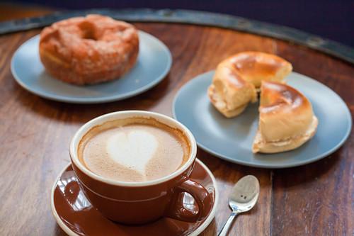 Latte, plain bagel with cream cheese and cinnamon sugar donut