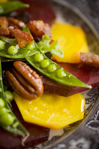Beetroot salad with peas and pecans
